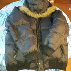 Winter Jacket Down feather puffy winter jacket with detachable sleeves and hood to make a vest. Like any other down item the feather do periodically come out. Super warm. GL Vibes Jackets & Coats