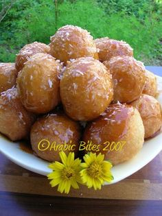 Elqaimat - These sweets are prepared during Ramadan in the Gulf. Very quickly doing and are really very tasty with the top burnt glaze and fluffy inside)