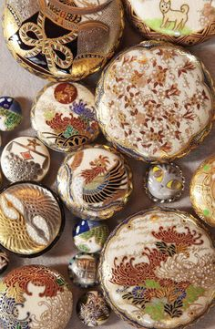 Wonderful group of mostly antique Japanese Satsuma buttons. Satsuma buttons are made from stoneware clay. NOT from porcelain.
