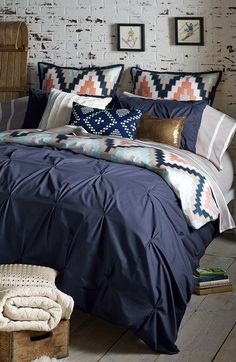 Create a calmer, more relaxed bedroom with shades of blue and beige.