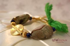 Lovely bracelet made of bright green silk, lapis lazuli, gold plated 925 silver elements, Akan gold weight.  #aflebijoux #bijoux #jewelry #etsy