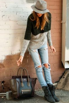 Oversized sweater distressed blue jeans and lace-up boots purse and hat