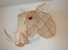 A warthog sculpture using sausage casing and sticks as armature.