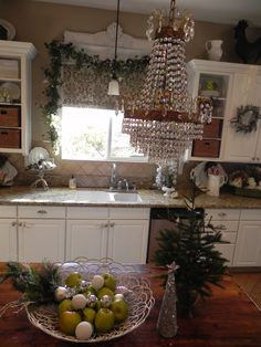Christmas Kitchen - The decor is cute but I absolutely love the crystal chandelier in a modest little kitchen.