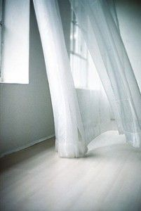What purity in motion are these curtains that waft in the breeze of  open windows.