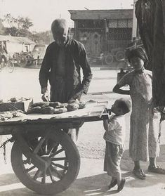 Memory of Old Beijing  - Photographer: Ms. Hedda Morrison (1908-1991). A Sweet Potato Vendor (This picture was taken in the late 1930's)
