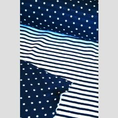 Navy - Double-Sided Jersey Spot and Stripe from Kiyohara.This is a double sided jersey made of 2 thin layers together, one a spot and one a stripe! 75cm wide. The price is for 25cm.£4.00