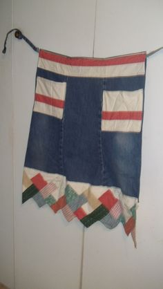 legs of jeans with sewn on pockets and trim from a curtain valance
