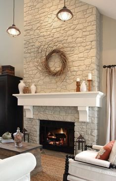 00 paint fireplace rock off-white. add reclaimed wood mantle or something like this. paint fireplace rock off-white. add reclaimed wood mantle or something like this. Living Room Corner, Home, Home Fireplace, Corner Fireplace Makeover, New Homes, Fireplace, Corner Fireplace Furniture Arrangement, Painted Rock Fireplaces