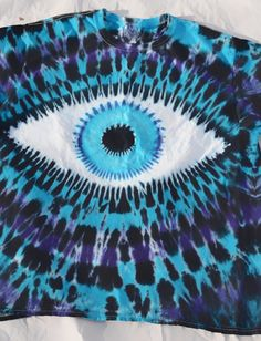 Check out this item in my Etsy shop https://www.etsy.com/listing/225595940/xl-tie-dye-eyeball-t-shirt