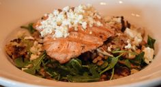"""Grilled Salmon and Warm Farro """"Salad"""" with roasted cauliflower, pine nuts, arugula and crumbled feta tossed with garlic-oregano dressing // Green Valley Grill Menu - Greensboro NC"""