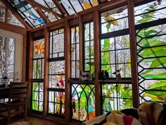 Stained glass artist and jeweler Neile Cooper had a vision for a sanctuary: a small cabin behind her home in Mohawk, New Jersey that would feature her glass designs on every available surface. The result is Glass Cabin, a structure built almost entirely from repurposed window frames and lumber that