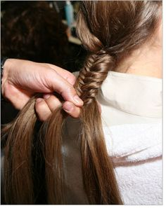 "How to Fishtail Braid  Move beyond the basic braid with a runway-inspired fishtail plait. Stylist Tommy Bucket explains how.        PRINT  E-MAIL    1. Spritz hair spray onto dry hair—Bucket suggests using Oribe Dry Texturizing Spray. ""Rake your hands through your hair instead of a brush and you'll get that modern, ropey look,"" Bucket says.    2. Separate hair into two equal sections at the back of the head. Fishtail braiding requires only two sections (not three, like a classic or French braid).    3. U..."