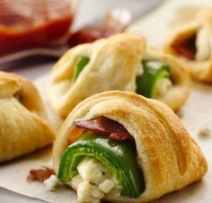 Jalapeno poppers get a savory upgrade in the form of flaky Crescent dough. A dollop of sweet salsa and herbed cheese make them even more delicious. These poppers have dozens of 5-star ratings. Check out the comments for Betty members' tips and tricks!