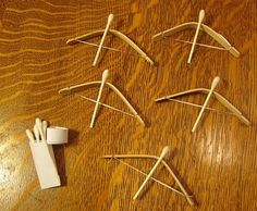 Bows and arrows that really shoot far from popsicle sticks, dental floss, and q tips!  Talk about awesome!