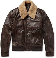 A part of the limited edition 'Pendine Sands' collection that celebrates the famed Welsh Tourist Trophy race, this Belstaff jacket is named for Mr Malcolm Campbell, who set a world land-speed record there in 1924. It has been made in Italy from dark-brown leather and is complete with sporty ribbed trims and a checked cotton lining. Detach the shearling collar on warmer days.