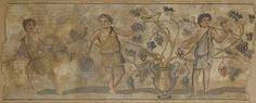 Mosaïque aux vendangeurs. Mosaïque représentant trois vendangeurs autour d'un grand canthare d'où émergent des pampres de vigne. Ils sont vêtus de tuniques courtes dégageant en partie le torse. Le premier, à gauche, tient de la main gauche un panier chargé. Le deuxième tient de la main droite une grappe de raisin, et cueille de la gauche une autre grappe. Le troisième, tourné vers la droite, tient un bâton orné de rubans, et cueille des raisins. Art Romain, IVe-Ve siècle. H_84 cm L_212 cm