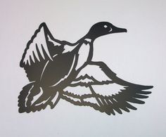 This handmade Duck silhouette wall hanging is a great addition to any home indoors or out. It is crafted from 16 gauge steel that has been painted black. It is approximately 16 1\/2W x 12 1\/2H and comes with matching nails for wall mounting.    I take great pride in my creations and want you to enjoy them as much as I have in making them. Quality is never sacraficed.    Due to the handcrafted nature of my products, small variances in apearance will occur, which give each piece a uniqueness…