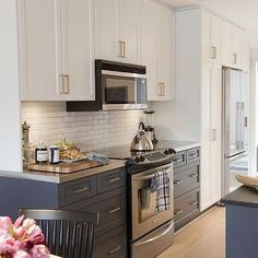 White wall cabinets with gray base cabinets
