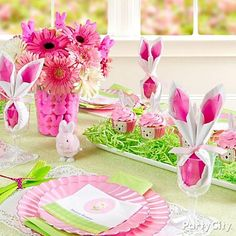 "Create a playful pink and green Easter tablescape ""everybunny"" will love! Click for details on creating the centerpiece, cupcakes and DIY bunny-ear napkins!"