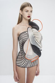 Garments influenced by distorted digital drawings featuring 3D-printed elements | 3D Print : Fashion + Photography | Design: Noa Raviv | Photo: Ron Kedmi |