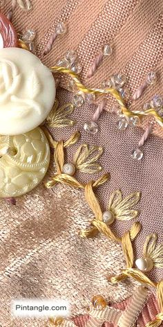 A brief article on what Rayon Ribbon Floss is and why it is useful in hand embroidery. Photo example of how it is used.