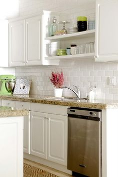 That looks like our granite (so I can picture white cabs, white subway tile, and stainless appliances).