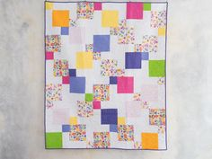 This celestially-inspired quilt gives the appearance of curved pieces and complex Y-seams. In truth, it's put together with four simple, straight stitched  blocks! Use the included paper templates for one of the blocks, or streamline the process with your Tri-Recs tool. Full-color instructions walk you through each step of this gorgeous quilt, which features Boundless Blenders Botanical fabrics.