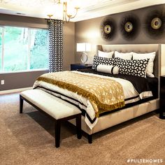 Gold tones paired with black accents creates gothic-chic vibes in this stunning bedroom! | Pulte Homes