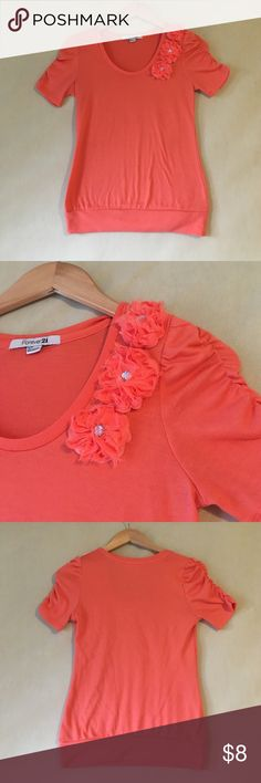 Forever 21 shirt with flower embellishments Forever 21 shirt with cute flower and jewel embellishments. So soft, 97% polyester, 3% spandex. Excellent used condition no stains or holes. Forever 21 Tops