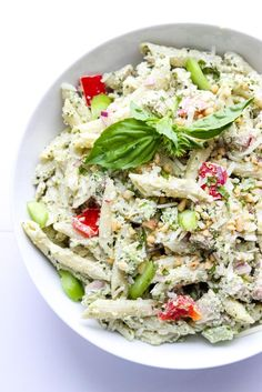 Creamy Yogurt Pesto Chicken Pasta - Made with healthy Greek yogurt, basil pesto, vegetables, and cooked chicken. Super creamy but without the loaded calories!