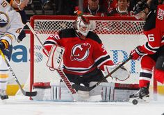 NEWARK, NJ - NOVEMBER 12: Cory Schneider #35 of the New Jersey Devils eyes the puck on a shot by the Buffalo Sabres during the game at Prudential Center on November 12, 2016 in Newark, New Jersey. (Photo by Paul Bereswill/NHLI via Getty Images)