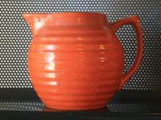 5 ¾ inch Vintage round pottery pitcher from Holland nice orange color and ribbed