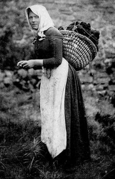 'Woman Crofter carrying a Peat basket' ~ Isle of Harris. Crofting is a form of land tenure and small-scale food production unique to the Scottish Highlands. Peat is used as fuel for cooking fires.