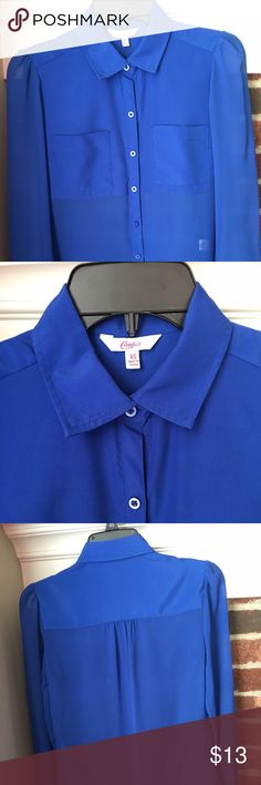 Candie's Royal Blue Blouse Sz Junior XS Candie's royal blue buttoned down blouse size Junior XS.  See through except shoulder areas. Two front pockets. It is in good condition without holes or stains. It was kept in a pet free and smoke free home. Candie's Tops Blouses