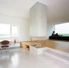 Love the timber floor meeting the concrete floor, also the fireplace effect! :: FIREPLACES :: INTERIORS :: beautiful fireplace design by X Architekten