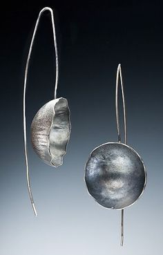 Capri Earrings by Nina Mann - Sterling silver, roller printed, forged and fabricated with long arcing wire.