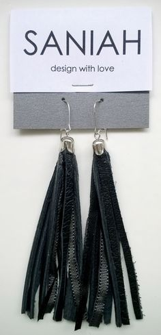 Hapsu earring with black leather and black & grey satin ribbons. Made of industrial surplus and recycled materials.