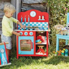 cuisine enfant bois avec une cuisinière et dosseret à motif damier