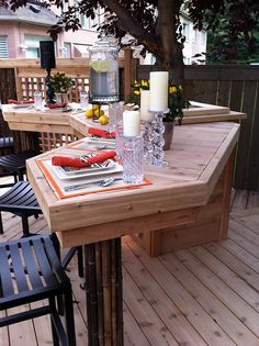 """A large, angled bar, built around an existing tree from """"Decked Out"""" project """"The Sideways Deck"""".  Deck Design by Paul Lafrance Design."""