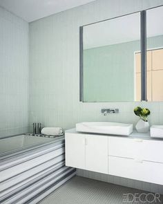 Loving the striped bathtub The walls and floors of the master bath are sheathed in glass tiles.