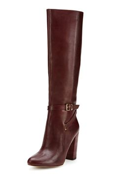Knee-High Heeled Boot A stacked heel is not that scary with the extra security of a knee-high boot.