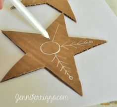Use white gel pen to add designs to recycled cardbaord