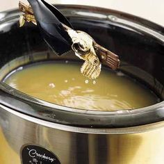 To strip paint-caked door hardware, buy a thrift-store Crock-Pot and fill it with water and 2 tablespoons of liquid laundry detergent. Drop in hinges, knobs, and escutcheons. Heat on medium overnight. By morning, the paint will be falling off the metal.