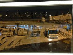 "Our plane, all by itself at 5am, in the midst of 4"" of ice, sleet, and snow at DFW"