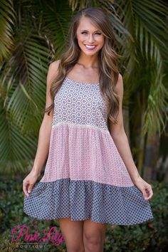 To say we are in love with this dress would be an understatement! Spaghetti strap dress with a unqiue print and flowy feel!