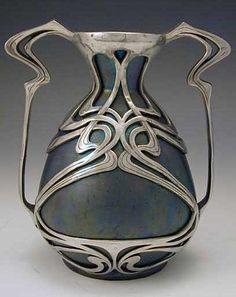 ZsolnayCeramic art nouveau vase with polished pewter mount, Hungary, c. 1900http://www.titusomega.com/