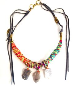 De Petra Art in Jewelry neon color block necklace with leather, brass and moonstone.   We just love color and to be bold.