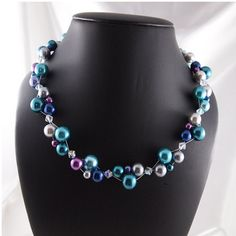 Peacock Cluster Glass Pearl Necklace by ChainedByLightness on Etsy, $48.00