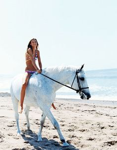 I am soooooo jealous, first because you are riding a horse, 2nd because you are in a warm climate and third you look great in a bikini!!!